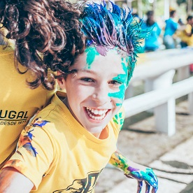 A boy smiles during a camp for underserved children in Portugal. LCIF awarded Leos a grant to make the camp possible.