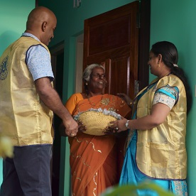 Lions deliver relief supplies to a flood victim in Kerala, India.
