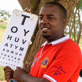 A Lion performs a vision test at a trachoma project site in Uganda.